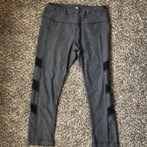 Work our cropped pants. Mid calf length.